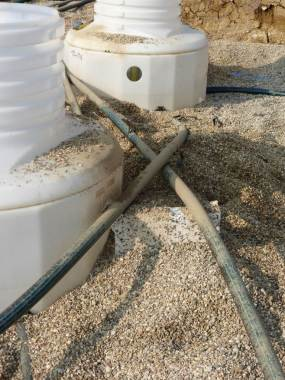 Pipes and spacers have been displaced and sumps contaminated by careless backfilling.