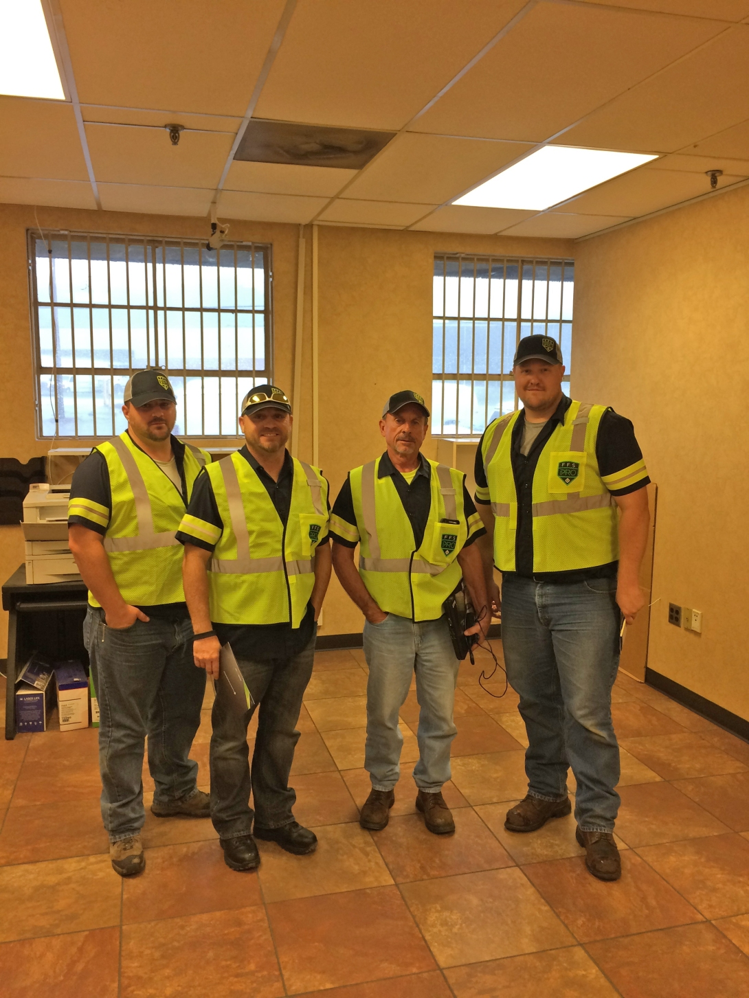Kevin Griffith, Terry Brandlett, Jimmy Thorne and Mark Moon wearing their FFS PRO high-vis safety gear.